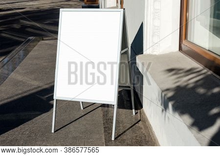 Signboard On The Street. Angled Empty Menu Board Stand. Restaurant Sidewalk White Sign Board. Freest