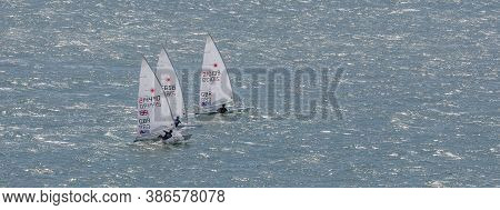 Portland Harbour, United Kingdom - July 3, 2020: High Angle Aerial Panoramic Shot Of Three Laser Cla