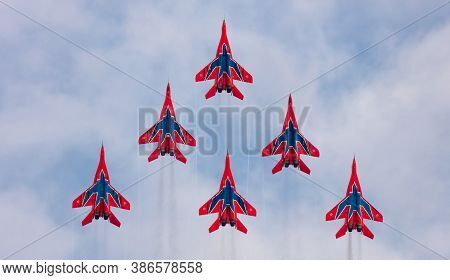 Barnaul, Russia - September 19, 2020: A Shot Of Strizhi Mig-29 Fighter Jet Squadron Performing Verti