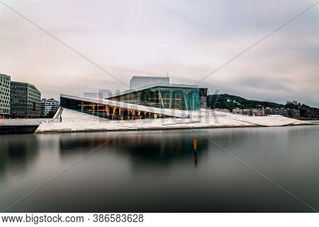 Oslo, Norway - August 10, 2019: Exterior View Of Opera House In Oslo. Long Exposure At Dusk. New Mod