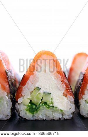 Seafood Delicatessen Salmon Sushi Rolls On Plate. Seafood Delicatessen Salmon Sushi Rolls On Plate.
