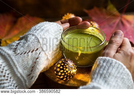 Green Japanese Matcha Tea With Foam In Transparent Cup On Wooden Table In Autumn Still Life. Women\'