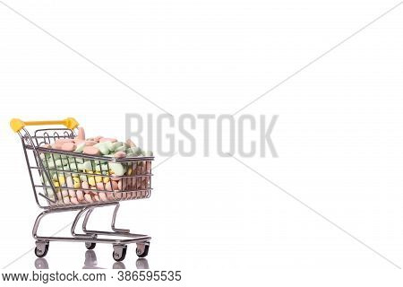 Close Up Shopping Cart With Medicines Isolated On White Background. Healthcare, Pharmacy, Drugstore,
