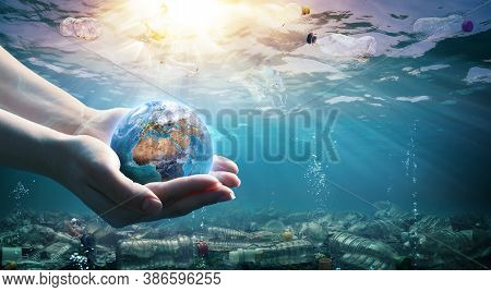 Plastic Waste In The Environment - Ocean Pollution - Hands Holding Earth - Elements Of This Image Fu