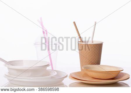 Plastic Vs Natural Materials. Plastic Dinnerware Against Craft Paper Set. Harmful Pollution, Environ
