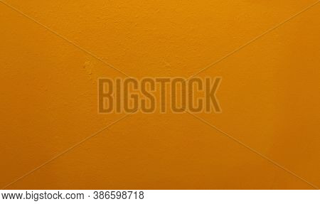 Orange Colored Painted Wall Background Or Texture