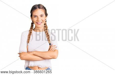 Beautiful caucasian woman with blonde hair wearing braids and white tshirt happy face smiling with crossed arms looking at the camera. positive person.
