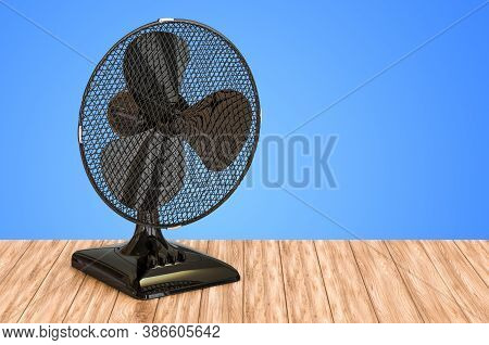 Table Fan On The Wooden Table. 3d Rendering