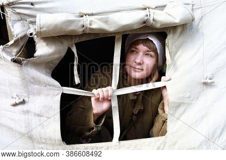 Nurse Looks Out Of  Window Of Militaryhospital