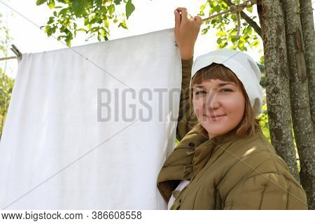 Woman Hangs Up Laundry To Dry
