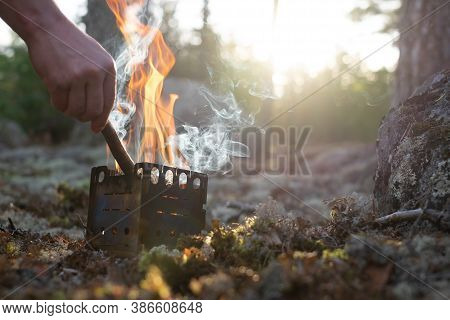Fire In Forest Camp. Special Small Splinter Tourist Campfire.