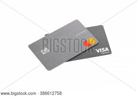 New York, Usa - August 25, 2020: Two Silver Credit Cards Visa And Mastercard Platinum Isolated On Wh