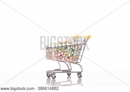 Shopping Trolley Filled With Medicines Pills Isolated On White Background. Healthcare, Pharmacy, Dru