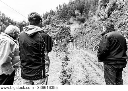 Omalo, Georgia - June 11, 2016: Workers With Tractor Remove The Landslide On The Mountain Road, Tush