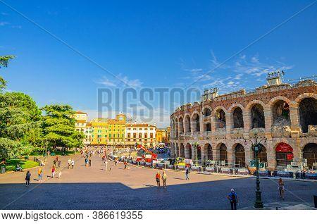 Verona, Italy, September 12, 2019: Piazza Bra Square In Historical City Centre With Verona Arena Rom