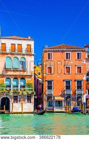 Grand Canal Waterway In Venice Historical City Centre With Gondolier On Sailing Gondola And Venetian