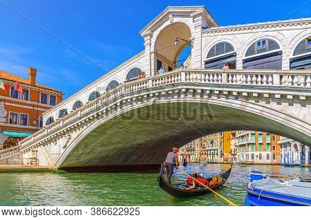 Venice, Italy, September 13, 2019: Venice Cityscape With Rialto Bridge Across Grand Canal Waterway,