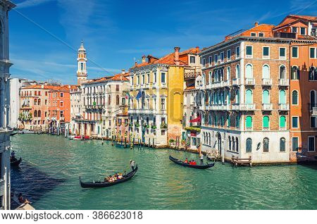 Venice, Italy, September 13, 2019: Gondolier On Gondola Traditional Boat Sailing On Water Of Grand C