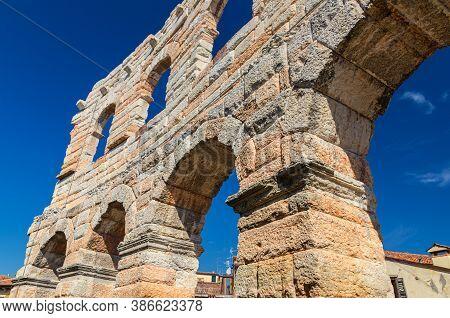 Limestone Walls With Arch Windows Of The Verona Arena In Verona City Historical Centre, Roman Amphit