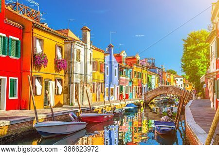 Colorful Houses Of Burano Island. Multicolored Buildings On Fondamenta Embankment Of Narrow Water Ca
