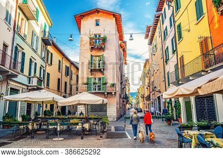 Brescia, Italy, September 11, 2019: Traditional Colorful Building With Balconies In Typical Italian