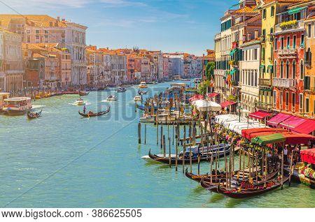 Venice Cityscape With Grand Canal Waterway. View From Rialto Bridge. Gondolas, Boats, Vaporettos Doc
