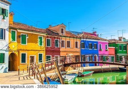 Colorful Houses Of Burano Island. Multicolored Buildings On Fondamenta Embankment Of Narrow Water Ca