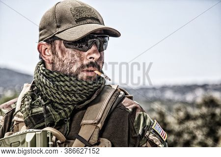 Shoulder Portrait Of Commando Fighter, Professional Mercenary Or Special Forces Shooter With Dirty F