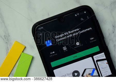 Google My Business Dev App With Magnifying On Smartphone Screen. My Business Is A Freeware Web Brows