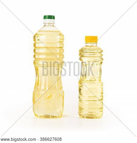 Two Bottles Of Sunflower Oil Isolated On White Background. Yellow Sunflower Or Vegetable Oil In A Li