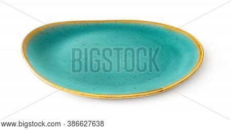 Side View Of Oval Turquoise Ceramic Plate With Yellow Border Isolated On A White Background. Empty C