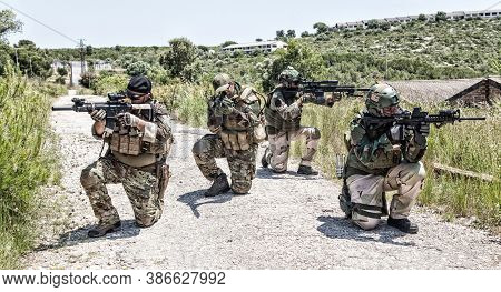 Seals Team Fighters, Army Special Operations Forces Soldiers Mowing With Caution On Road, Kneeling,