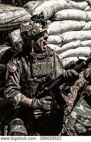 Navy Seals Rifleman, Army Soldier In Combat Uniform And Helmet, Grabbing Assault Rifle, Screaming, Y
