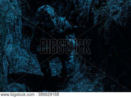 Army Soldier, Special Forces Infantryman In Combat Uniform And Helmet, Armed Assault Rifle, Sneaking