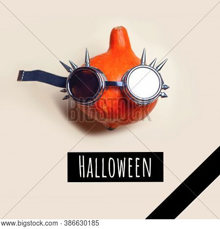Portrait Of Mr. Pumpkin In Punk Rocker Glasses. Halloween Concept