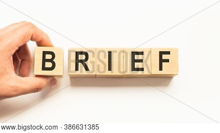Word Brief. Wooden Small Cubes With Letters Isolated On White Background With Copy Space Available.