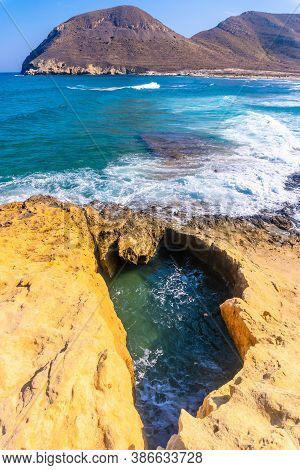 Natural Pool On The Rocks Of Playazo De Rodalquilar In The Natural Park Of Cabo De Gata, Nijar, Anda
