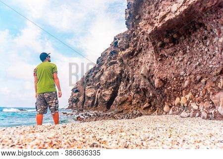 A Young Tourist On Playa De Los Muertos Next To The Rocks In The Cabo De Gata Natural Park, Nijar, A