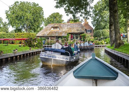 Giethoorn, Netherlands - 13 September 2020. View From The Boat Of Tourists Floating On The Canal Bet