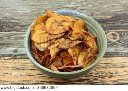 Sweet Plantain Chips Side Dish Or Snack In Ceramic Snack Bowl On Table