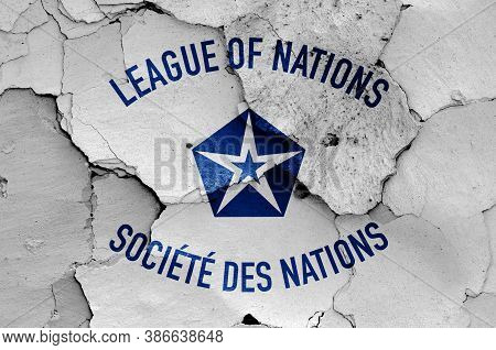 Flag Of League Of Nations Painted On Cracked Wall
