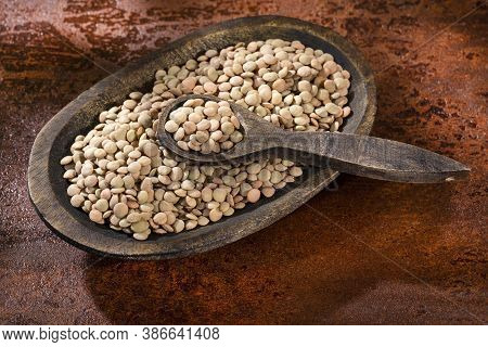 Lens Culinaris - Dried Lentils In A Small Bowl