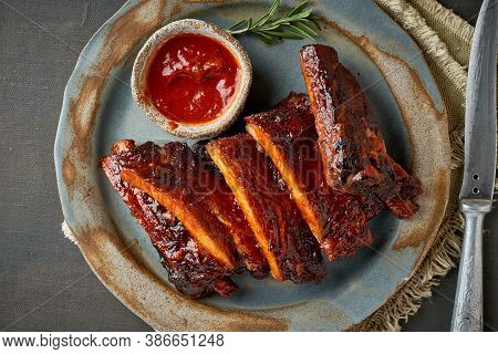 Keto Food, Barbecue Pork Ribs. Slow Cooking Recipe. Pickled Roasted Pork Meat With Red Sauce.