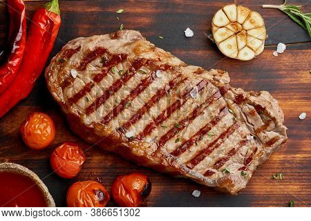 Whole Beef Steak, Fried Striploin On Wooden Cutting Board. Keto Ketogenic Diet. Close Up, Top View