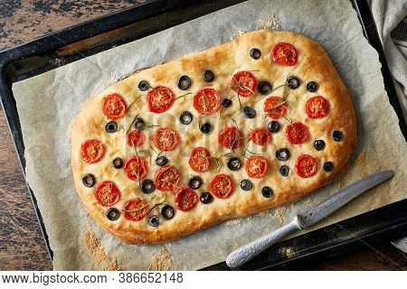 Focaccia, Pizza, Italian Flat Bread With Tomatoes, Olives And Rosemary On Tray
