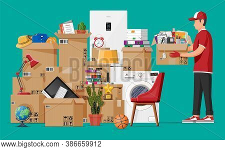 Moving To New House. Family Relocated To New Home. Male Mover, Paper Cardboard Boxes With Goods. Pac