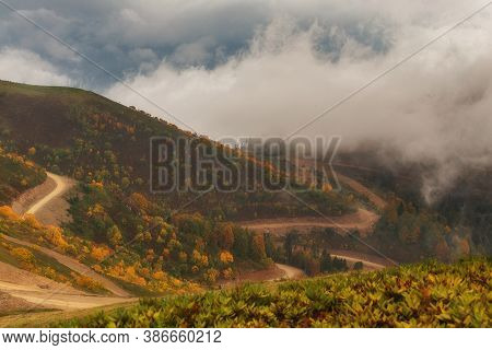 Beautiful Clouds In The Mountains. Picturesque Autumn Landscape. Sochi, Rosa Khutor, Rosa Peak
