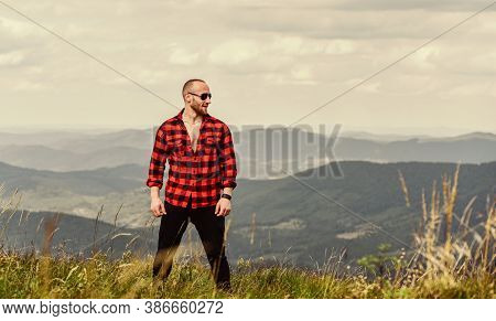 Power Of Nature. Man On Mountain Landscape. Camping And Hiking. Sexy Macho Man In Checkered Shirt. C