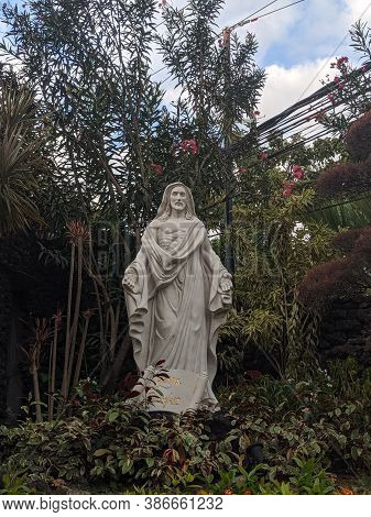 Denpasar, Indonesia - September 28, 2019: Jesus Statue On The Park Of Holy Spirit Cathedral.