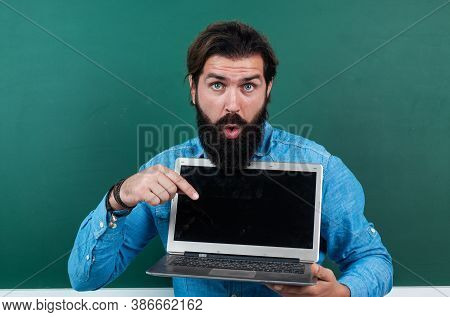 Surprised Mature Teacher Working On Computer. Brutal Bearded Man Work In Classroom With Laptop. Onli